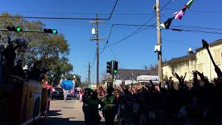 New Orleans Saints players throw beads in the Zulu parade during Mardi Gras 2018