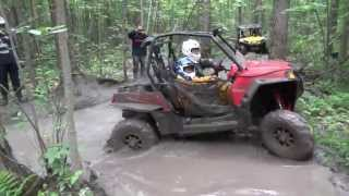 The Can Am Outlander, Kawasaki, and RZR trying the nasty hole.