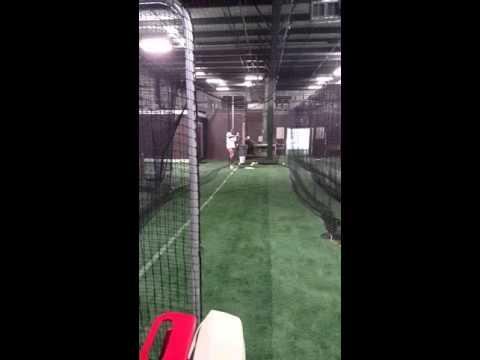 Softball Machine pitching a Rise Ball