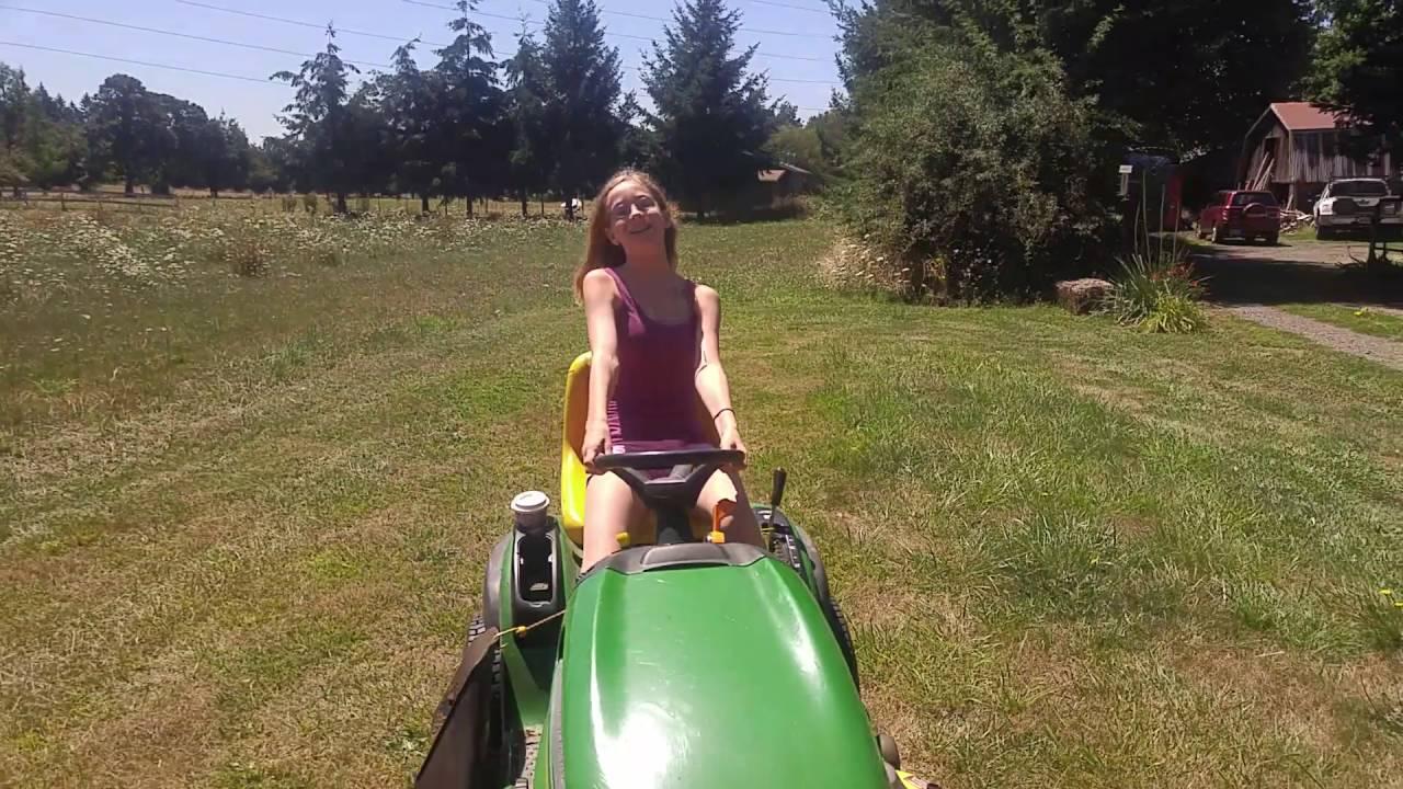 Girl riding lawn mower - YouTube