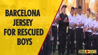 Boys rescued from Thai cave receive Barcelona soccer shirts