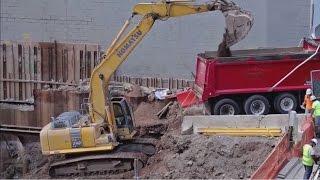 Komatsu PC240 loading dump truck