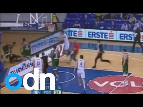 Man runs onto basketball court, shoves player, gets punched