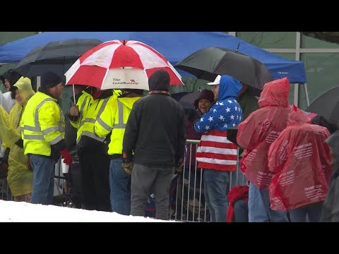 Supporters Line Up In The Rain Ahead Of Trump's Rally In New Hampshire | AFP