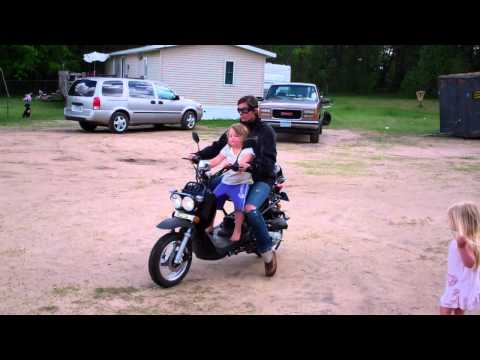 My grandaughter Kaylyn giving my other Grandaughters Sydnie and Addison a ride on her moped!