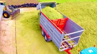 Push off Ejector Trailer Drone footage of HiSpec Kompactor & New Holland T7 at the Grass