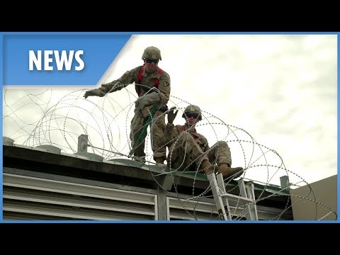 Operation Faithful Patriot: troops deploy barbed wire along the border