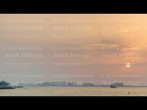 Dubai skyline with Burj Al Arab hotel during sunset timelapse.