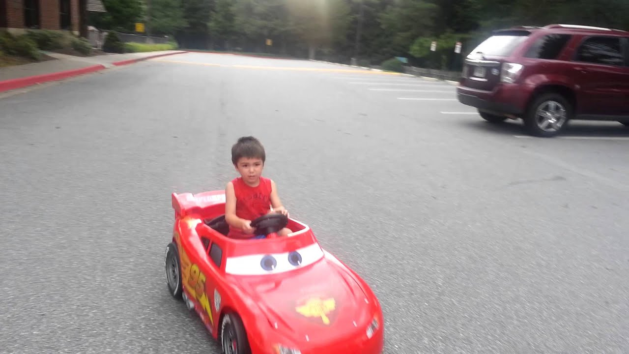 Cole driving his lightning mcqueen motorized kids car from CARS