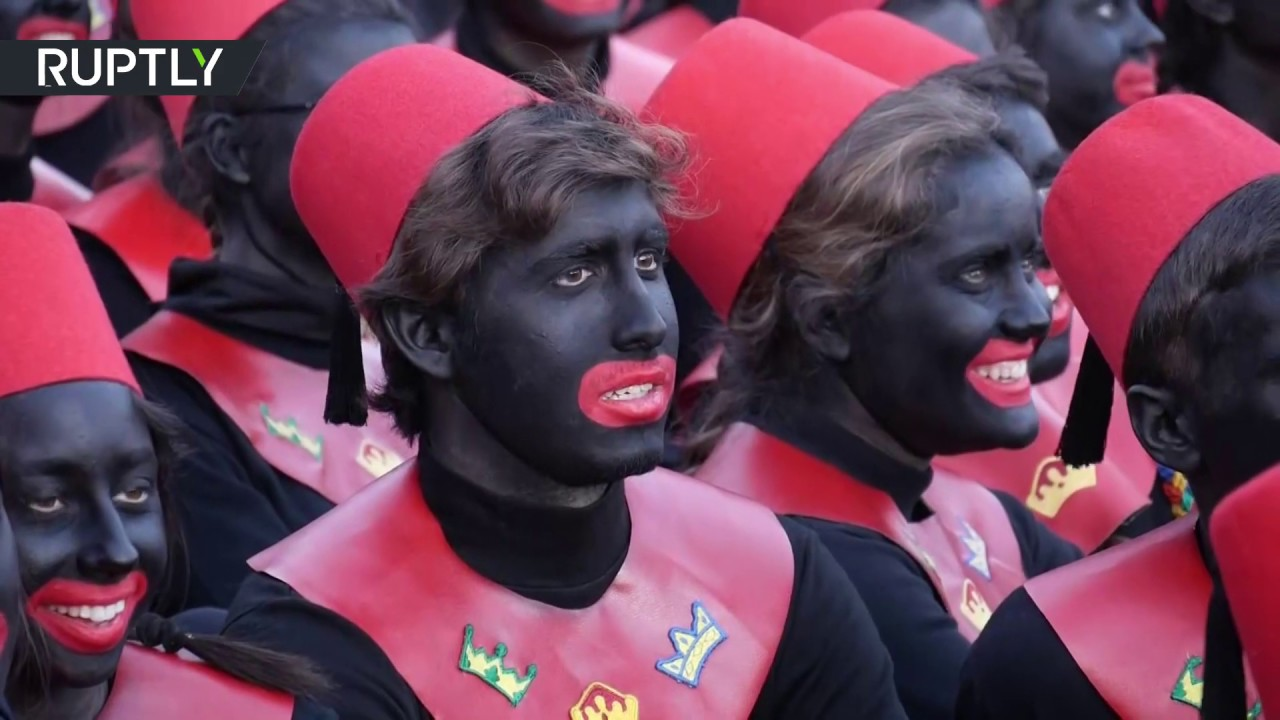Spanish teenagers don blackface and hand out gifts to children in parade