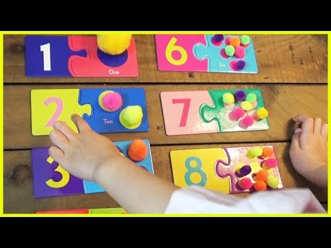 Fun way to learn numbers 1-10 using number cards and colorful pompoms