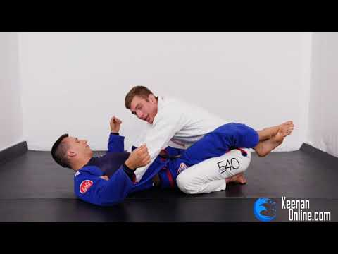 HOW TO ESCAPE THE MOST COMMON JIUJITSU ATTACK  - The closed guard escape. KEENANONLINE.COM