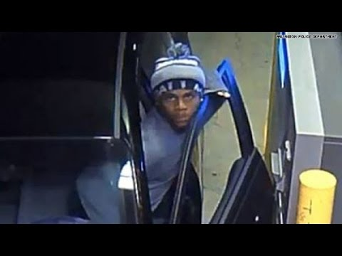 Carjacker forces woman in trunk, stares into camera