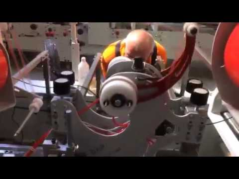 Double sided tape RAP applicator with Spooling system for long run