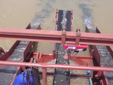 Chain bucket gold panning dredger is working in Central Africa--(whatsapp:0086-18363682790)