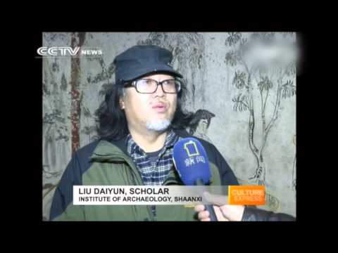 Chinese ink paintings line the walls of ancient tomb