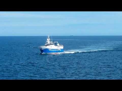 Rolling Fishing Vessel Approaching Peterhead Harbour