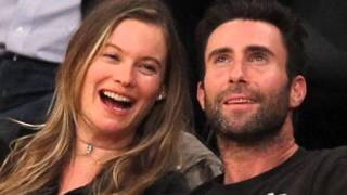 behati prinsloo and adam levine enjoy a pre baby date night as they cosy up courtside