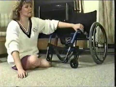 image Paraplegic woman climbing stairs