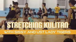 Nathan with the UST Womens Volleyball Team