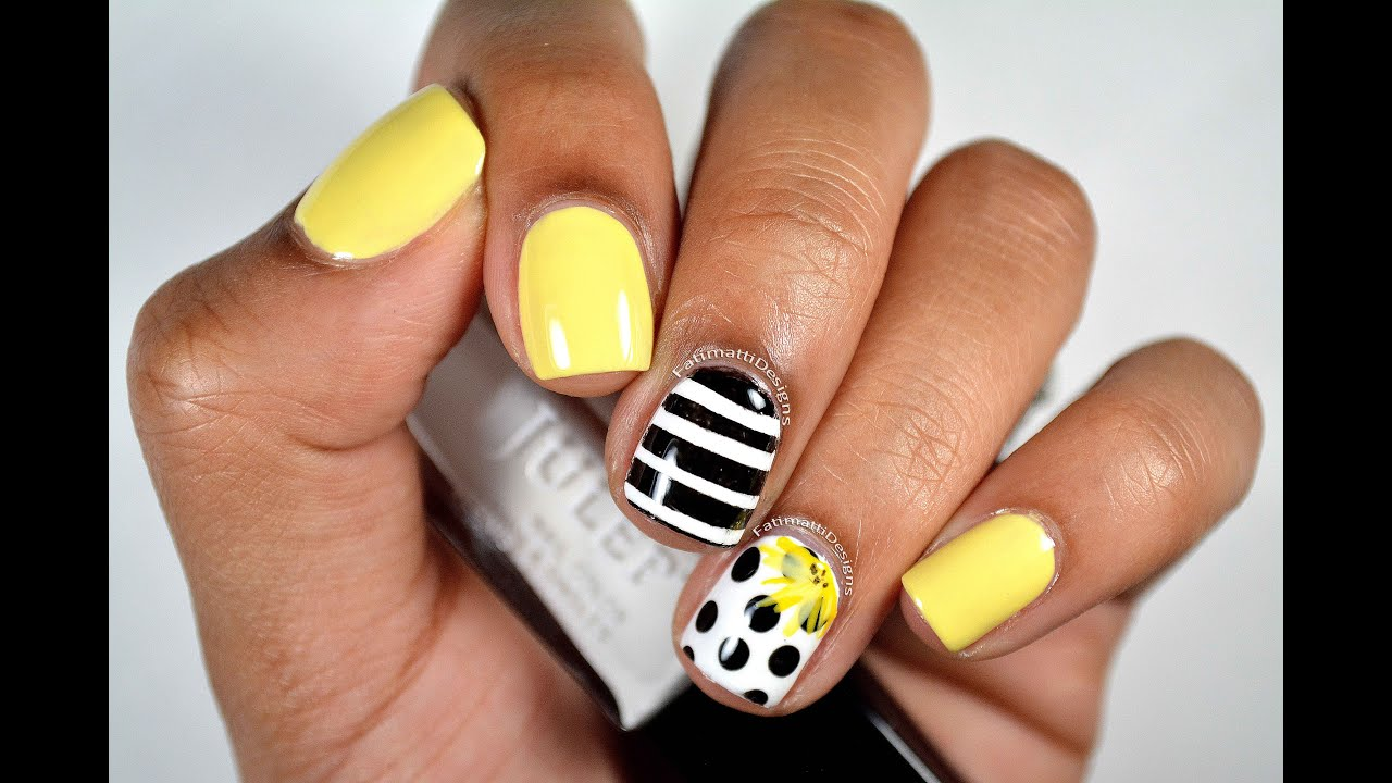 diy black and white polkadotted nail art with yellow accent flower youtube