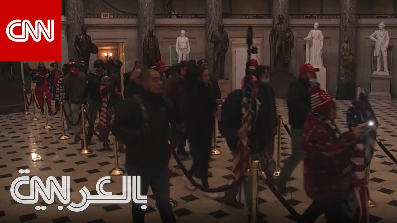 لحظة اقتحام متظاهرين مبنى الكونغرس والتجول فيه