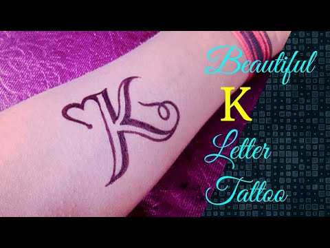 Beautiful K letter tattoo on hand by