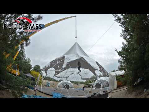 Polidomes geodesic domes tent assembly at polish desert.