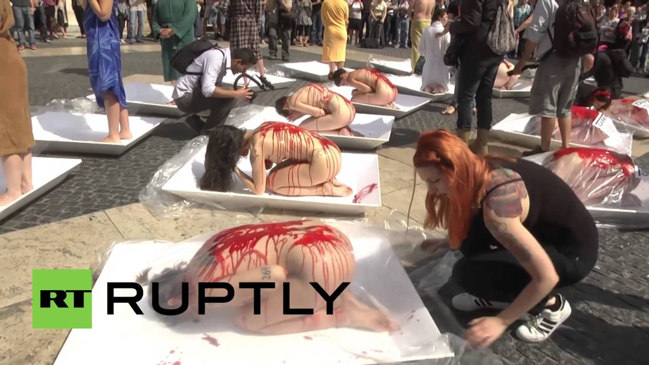Spain: Vegan activists use their bodies to protest meat industry *EXPLICIT*