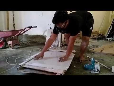 memotong granit