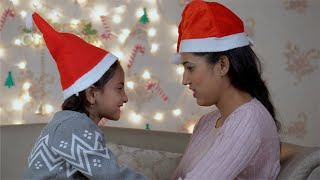 Young women cheerfully playing with her cute daughter on Christmas Eve