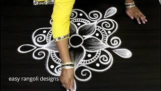 Easy n cute rangoli    simple designs   latest muggulu      cute flower kolam