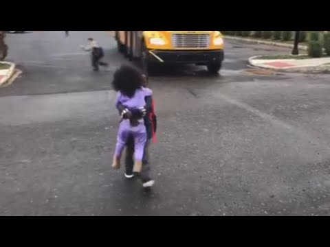 Sister Runs to Give Big Brother a Hug as He Gets Home from School