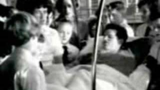 1964 - Edward 'Ted' Kennedy recovering from planecrash