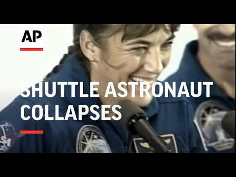 Shuttle astronaut collapses during welcome home ceremony