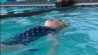 Toddler jumps into pool and swims with ease