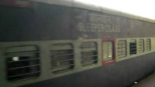 Train leaving station at Agra, India - Human waste on tracks