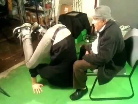 Kumar Pallana teaching Andrew Swant how to yoga