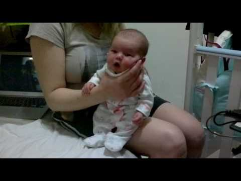 Mommy burps the baby after drinking milk