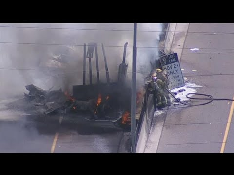 VIDEO: Semi catches fire after crashing into median wall on I-10 in Phoenix