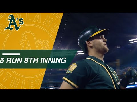 Pinder's grand slam caps A's 5-run 8th inning