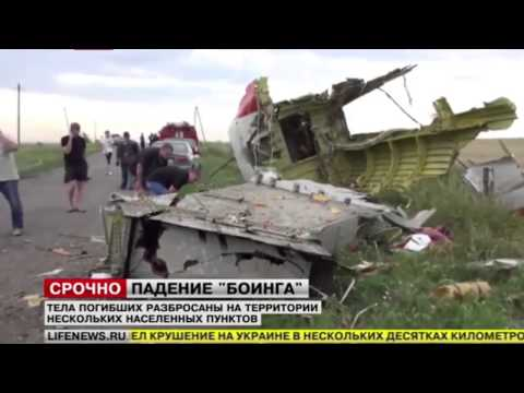 Malaysia flight MH17 Crach Site Dead Bodies, Passport and Body Part   Horrible !!! 1