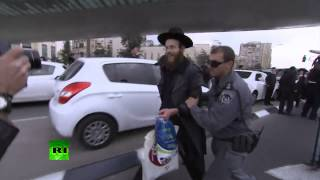 Jews v Cops: Ultra-Orthodox protest against plan to draft them into IDF