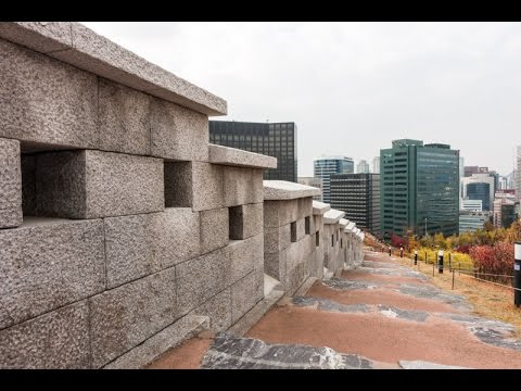 The imposing Seoul Fortress Wall running through Namsan Park in Seoul, South Korea