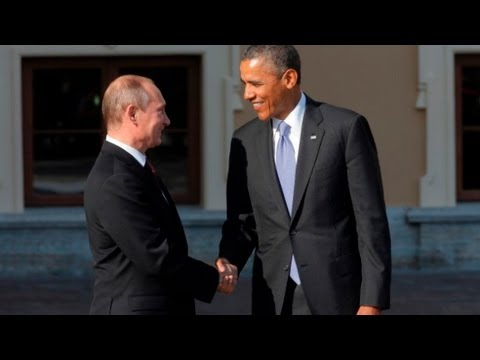 Obama and Putin greet with long handshake