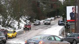 cars sliding on ice on Gilman