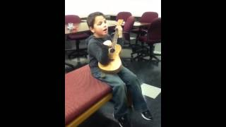 Trenton playing the ukulele
