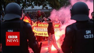 German rival protests end in violence - BBC News
