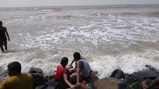 Romantic Couple are enjoying sea bath in Digha sea Beach