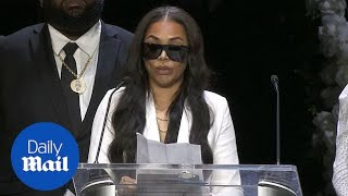 Hussle's girlfriend Lauren London and Snoop Dogg give emotional speech